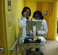 Dr. Davis and Dr. Isles using the electronic health record
